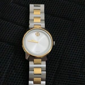 This is a silver and gold Movado watch